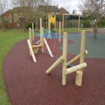 Rubberised Playground Bark Installer in Abbey Gate 6