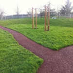 Rubberised Playground Bark Installer in Abbey Gate 7