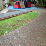 Rubberised Playground Bark Installer in Anstey 3